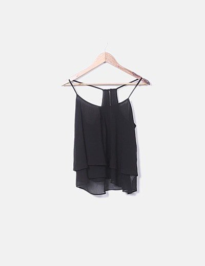 Blusa semitransparente negra volantes