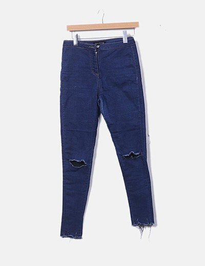 Jeans elástico  de tiro alto con roto en las rodillas