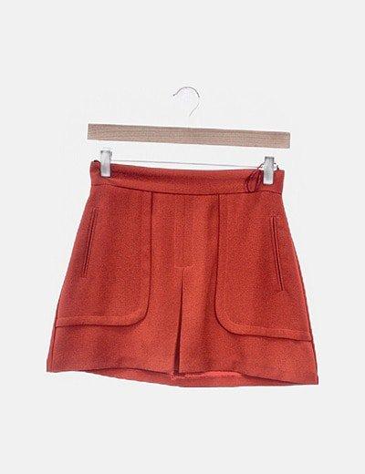 Mini falda roja bolsillos