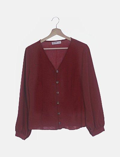 Camisa teja con botones marrones