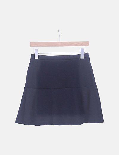 Mini falda negra volante