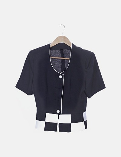 Conjunto falda y chaqueta negro y blanco