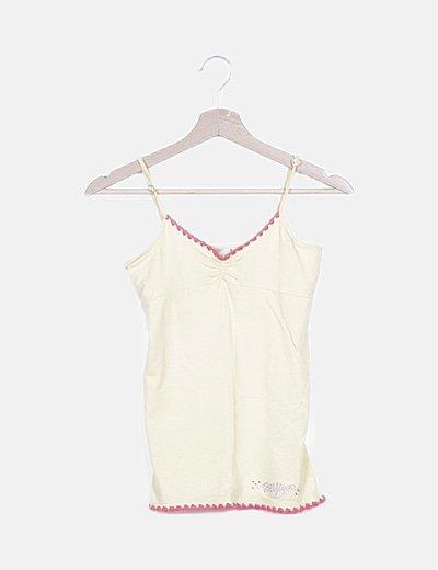 Camiseta amarilla detalles rosas y strass