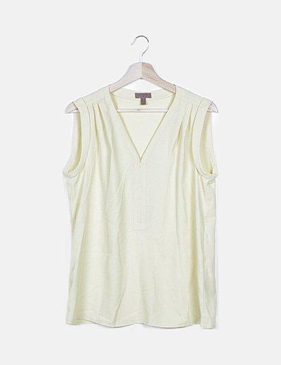 Blusa amarilla sin manga detalle cremallera