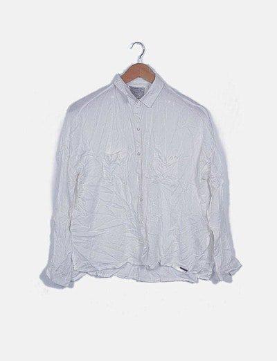 Camisa fluida blanca con bolsillos