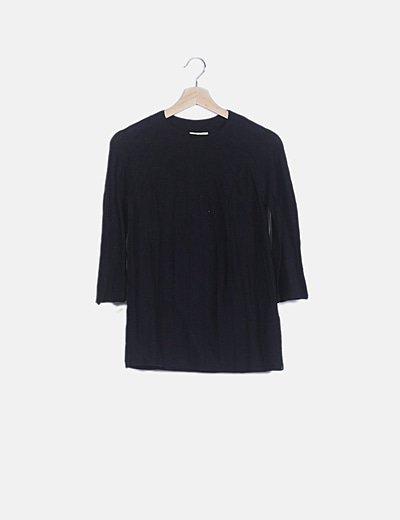 Suéter negro plisado manga larga