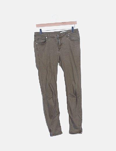 Jeans skinny verde efecto desgastado