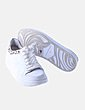 Deportiva blanca detalle animal print Zara