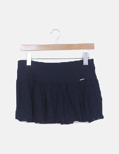 Minifalda azul marina troquelada