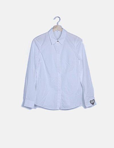 Camisa blanca botón pedrería