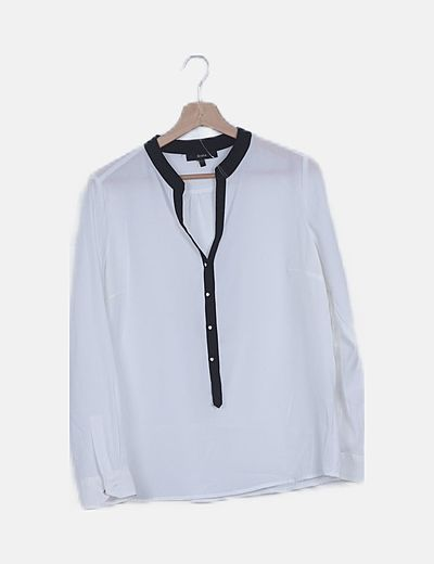 Blusa blanca ribetes