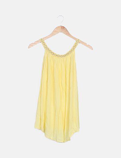 Blusa amarilla cuello glitter