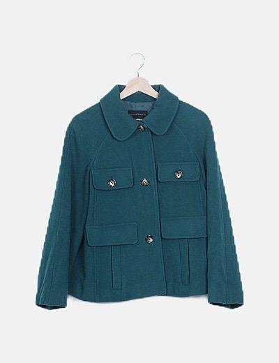 Purificación García trench coat