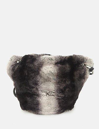 Bolso pelo negro y blanco combinado