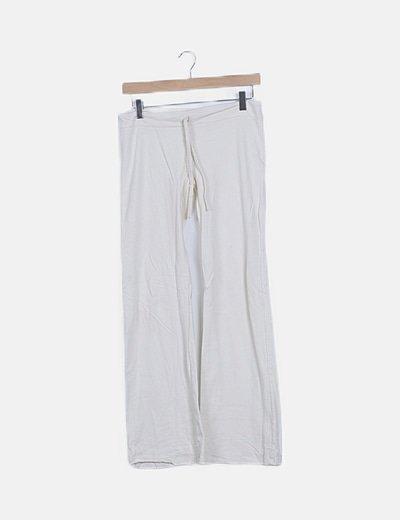 Pantalón deportivo blanco acampanado