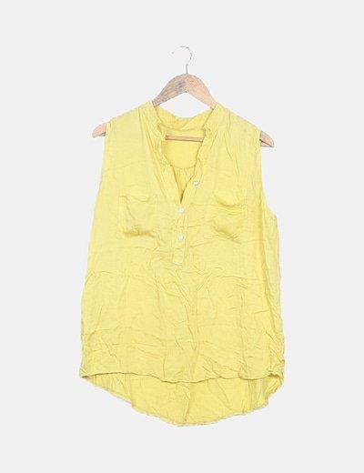 Blusa amarilla con bolsillo