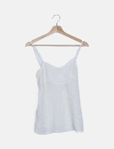 Blusa blanca detalles plisados