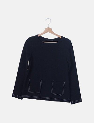 Blusa negra con bolsillos