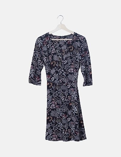 Vestido fluido negro floral escote cruzado