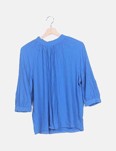Blusa fluid azul detalle drapeado