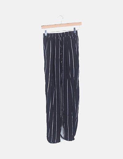 Pantalón negro rayas blancas