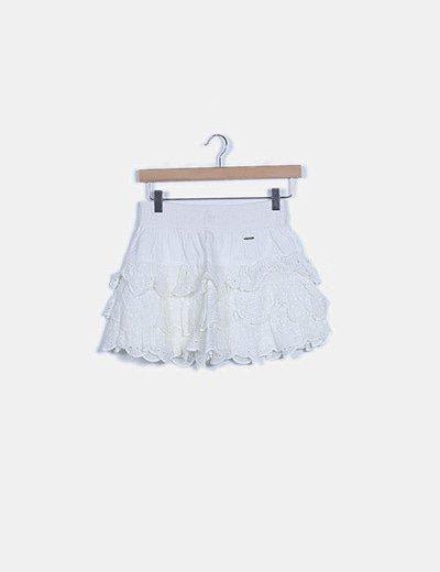 Mini falda blanca volante