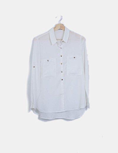 Camisa blanca semitransparente botón dorado
