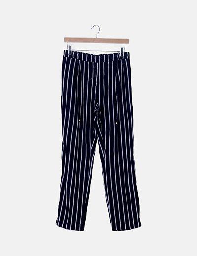 Pantalón fluido azul con rayas blancas