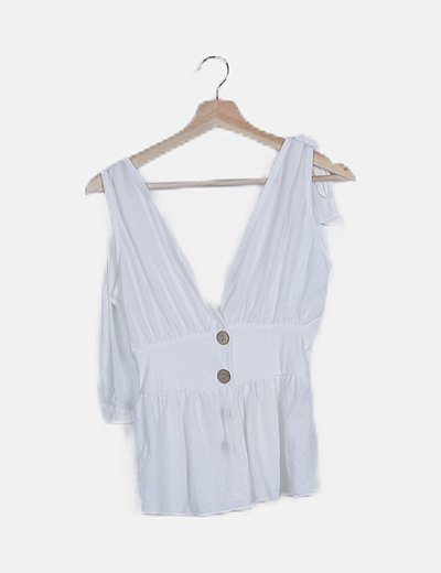 Blusa fluida blanca detalle botones