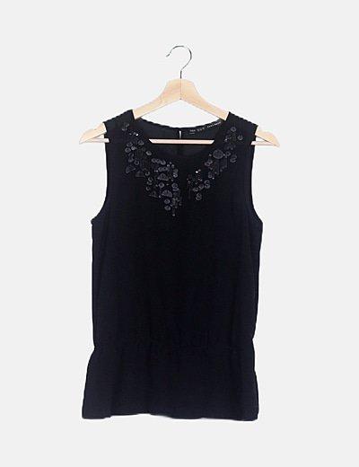 Blusa semitransparente negra