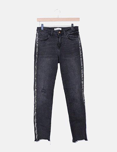 Jeans denim negro ribete lateral animal print