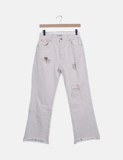 Jeans beige campana con rotos