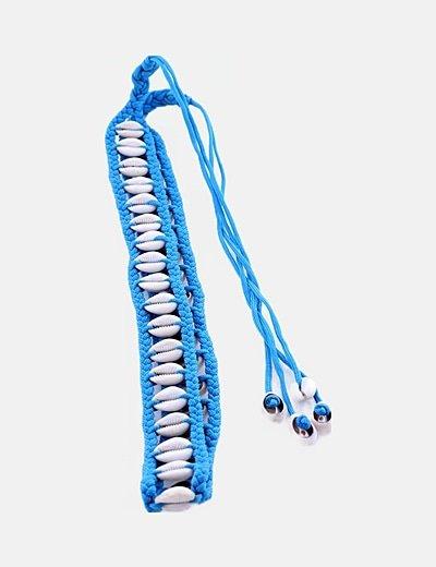 Cinturón azul con conchas