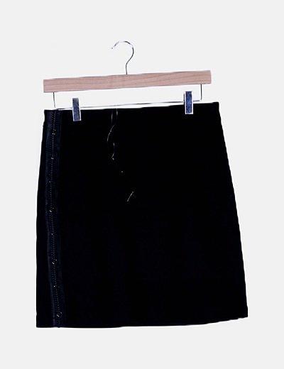 Falda negra detalle trenzado