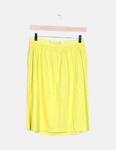 Falda amarilla bolsillos