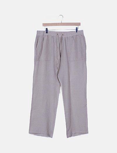 Pantalón beige fluido con bolsillos