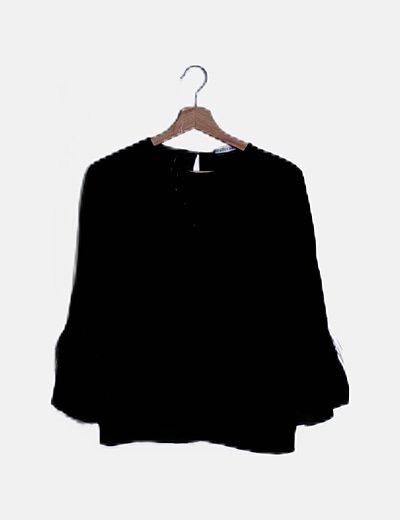 Blusa negra detalle flecos