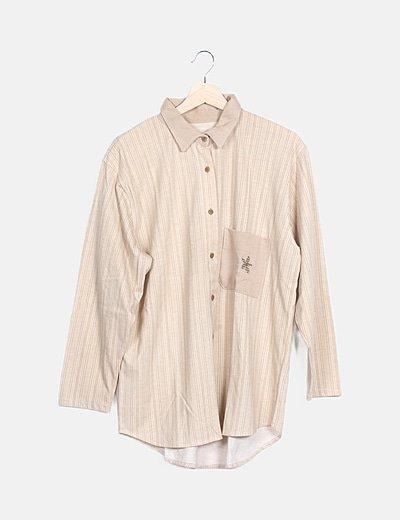 Camiseta bicolor detalle bolsillo