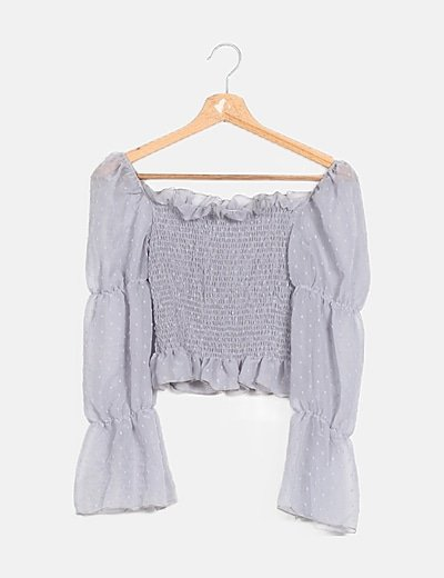 Top peplum gris semitransparente