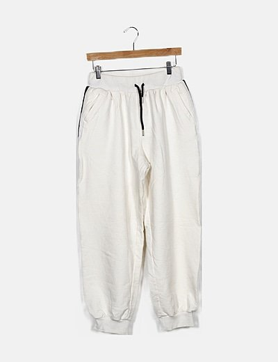 Pantalón deportivo beige detalle banda