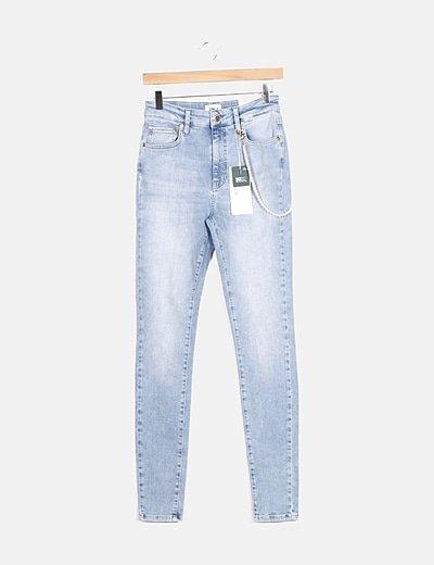 Jeans efecto desgastado detalle perlas
